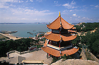 Pagoda of Matzu Temple complex from Meizhou Isand, China, with Fujian coastline on horizon. The Goddess Matzu is patron saint of fishermen in these parts.  .2004