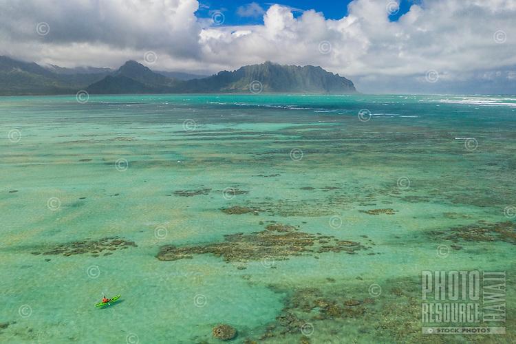 A kayaker navigates the waters at Kaneohe Sandbar (or Ahu o Laka), Windward O'ahu.
