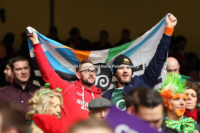 Pictured: A welsh and an Irish supporter holding a flag Saturday 14 March 2015<br /> Re: RBS Six Nations, Wales v Ireland at the Millennium Stadium, Cardiff, south Wales, UK.