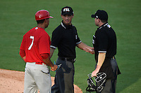 Palm Beach Cardinals manager Oliver Marmol (7) discusses a call with umpires Derek Gonzales (middle) and Ryan Doherty during a game against the Lakeland Flying Tigers on April 13, 2015 at Joker Marchant Stadium in Lakeland, Florida.  Palm Beach defeated Lakeland 4-0.  (Mike Janes/Four Seam Images)