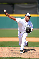 Detroit Tigers pitcher Octavio Dotel #20 delivers a pitch during a Spring Training game against the Tampa Bay Rays at Joker Marchant Stadium on March 29, 2013 in Lakeland, Florida.  (Mike Janes/Four Seam Images)