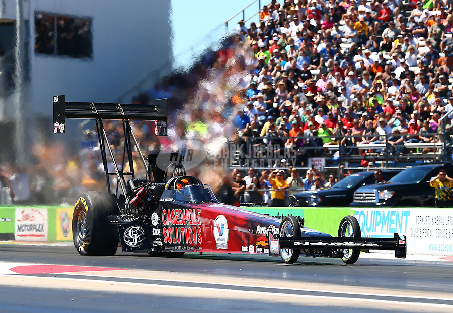 Sept. 21, 2013; Ennis, TX, USA: NHRA top fuel dragster driver Clay Millican during the Fall Nationals at the Texas Motorplex. Mandatory Credit: Mark J. Rebilas-
