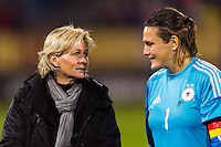 Germany (GER) head coach Silvia Neid talks with goalkeeper Nadine Angerer (1) after the match. The United States (USA) and Germany (GER) played to a 2-2 tie during an international friendly at Rentschler Field in East Hartford, CT, on October 23, 2012.