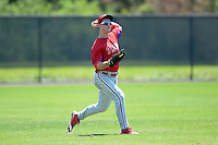 Philadelphia Phillies outfielder Cord Sandberg (24) throws the ball in during a minor league spring training game against the Pittsburgh Pirates on March 18, 2014 at the Carpenter Complex in Clearwater, Florida.  (Mike Janes/Four Seam Images)