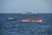 Sea Watch-2.<br /> Die Sea Watch-2 bei ihrer 13. SAR-Mission vor der libyschen Kueste.<br /> Im Bild: Die italienische Kuestenwache birgt Menschen aus Schlauchbooten.<br /> 22.10.2016, Mediterranean Sea<br /> Copyright: Christian-Ditsch.de<br /> [Inhaltsveraendernde Manipulation des Fotos nur nach ausdruecklicher Genehmigung des Fotografen. Vereinbarungen ueber Abtretung von Persoenlichkeitsrechten/Model Release der abgebildeten Person/Personen liegen nicht vor. NO MODEL RELEASE! Nur fuer Redaktionelle Zwecke. Don't publish without copyright Christian-Ditsch.de, Veroeffentlichung nur mit Fotografennennung, sowie gegen Honorar, MwSt. und Beleg. Konto: I N G - D i B a, IBAN DE58500105175400192269, BIC INGDDEFFXXX, Kontakt: post@christian-ditsch.de<br /> Bei der Bearbeitung der Dateiinformationen darf die Urheberkennzeichnung in den EXIF- und  IPTC-Daten nicht entfernt werden, diese sind in digitalen Medien nach §95c UrhG rechtlich geschuetzt. Der Urhebervermerk wird gemaess §13 UrhG verlangt.]