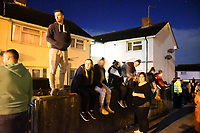 Pictured: Angry mob in Monkton, Pembrokeshire, Wales, UK. Tuesday 11 July 2017<br /> Re: A riot broke out in a quiet country village when more than 200 protesters threw stones and lit fires outside the house of a woman they suspected of being a sex offender.<br /> The angry mob shouting 'paedo' and 'nonce' were broken up by at about 4am when the 24-year-old woman and another person were escorted from the house by armed police.<br /> The crowd had gathered in Monkton, Pembrokeshire just after 9pm on Tuesday night after a series of sex allegations against the woman were made on Facebook.