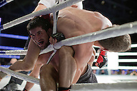 Moscow, Russia, 05/06/2010..Rasul Mirzaev and Marat Peksov become tangled in the ropes in a mix-fight bout during the new Fight Nights boxing tournament, featuring kick-boxing, boxing and mixed fighting.