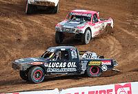 Mar. 20, 2011; Chandler, AZ, USA;  LOORRS pro lite driver Brian Deegan leads Rodrigo Ampudia during round two at Firebird International Raceway. Mandatory Credit: Mark J. Rebilas-