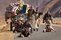Tibetan buddhist pilgirms inch their way to Lhasa by countless prostrations to gain karmic merit