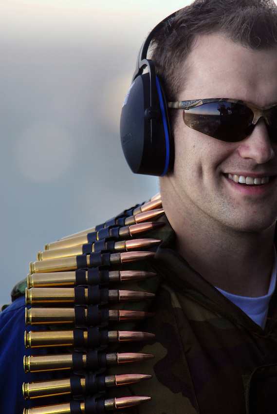 """071020-N-7981E-365 PACIFIC OCEAN (October 20, 2007)-Gunner's Mate 3rd Class Dustin Waggener celebrates a successful .50 Caliber machine gun target engagement following a """"killer barrel"""" exercise on the fantail of the Nimitz-class aircraft carrier USS Abraham Lincoln (CVN 72). Lincoln is underway for a scheduled work up to include Composite Training Unit Exercise (COMTUEX), an exercise designed to enhance the interoperability of the carrier and its strike group. U.S. Navy photo by Mass Communication Specialist 3rd Class James R. Evans (RELEASED)"""