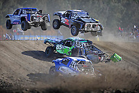 Dec. 19, 2009; Lake Elsinore, CA, USA; LOORRS unlimited four driver Travis Coyne (5) leads Chris Brandt (82), Justin Davis (85) and Jeff Geiser (44) during the last chance qualifying race prior to the Lucas Oil Challenge Cup at the Lake Elsinore Motorsports Complex. Mandatory Credit: Mark J. Rebilas-US PRESSWIRE