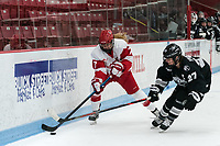 BOSTON, MA - JANUARY 11: Avery Fransoo #27 of Providence College challenges Jesse Compher #7 of Boston University during a game between Providence College and Boston University at Walter Brown Arena on January 11, 2020 in Boston, Massachusetts.