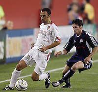 The MetroStars' Youri Djorkaeff and Jay Heaps of the Revolution contest for the ball. The New England Revolution defeated the MetroStars 4 to 2 at Gillette Stadium, Foxbourgh, MA, on June 25, 2005. Djorkaeff scored the MetroStars first goal off a penalty kick.