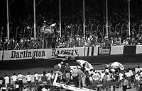 The #33 Chevrolet Monte carlo of Harry Gant takes the checkered flag to win the Southern 500 at Darlington Raceway in Darlington, SC on September 2, 1984. (Photo by Brian Cleary/www.bcpix.com)