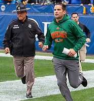 Miami Hurricanes head coach Manny Diaz runs onto the field before the game. The Miami Hurricanes football team defeated the Pitt Panthers 16-12 in a game at Heinz Field, Pittsburgh, Pennsylvania on October 26, 2019.