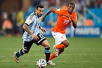 Ezequiel Lavezzi of Argentina takes on Georginio Wijnaldum of the Netherlands