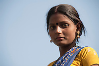 A young Indian woman gazes at the camera at a tribal village near Gwalior, India.