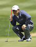 JEJU, SOUTH KOREA - APRIL 24:  Anthony Kim of USA lines up a putt on the 14th green during the Round Two of the Ballantine's Championship at Pinx Golf Club on April 24, 2010 in Jeju island, South Korea. Photo by Victor Fraile / The Power of Sport Images