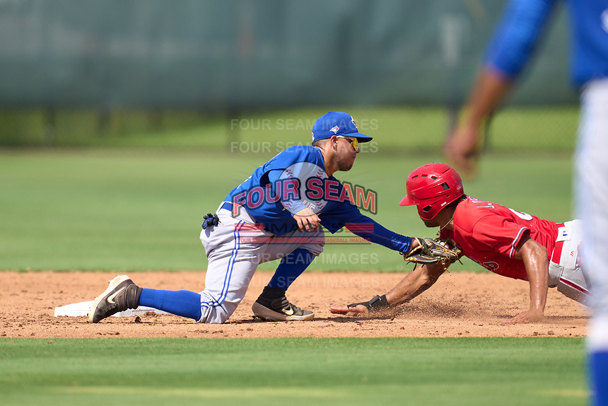 Toronto Blue Jays second baseman Adrian Montero (14) tags Jose Cedeno out during an Extended Spring Training game against the Philadelphia Phillies on June 12, 2021 at the Carpenter Complex in Clearwater, Florida. (Mike Janes/Four Seam Images)