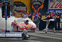 Oct. 31, 2008; Las Vegas, NV, USA: NHRA pro stock driver Justin Humphreys does a burnout past a crew member dressed as a matador for Halloween during qualifying for the Las Vegas Nationals at The Strip in Las Vegas. Mandatory Credit: Mark J. Rebilas-