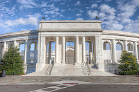 Historic Arlington Memorial Amphitheater sits empty under partly cloudy skies on a warm autumn afternoon.  The amphitheater, dedicated in 1920, is located in Arlington National Cemetery in Arlington, Virginia.
