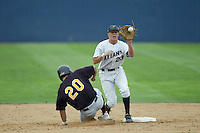 Justin Turner of the Cal State Fullerton Titans catches a throw at second base during a game at Goodwin Field on June 6, 2003 in Fullerton, California. (Larry Goren/Four Seam Images)