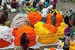 Marigold garlands for sale at a flower market, Kolkata, India