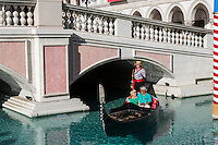 Las Vegas, Nevada.  Middle-aged Couple Enjoying a Ride in a Gondola at the Venetian Hotel and Casino.