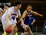 SIOUX FALLS, SD - MARCH 6: Justin Brookens #3 of the Western Illinois Leathernecks tries to steal the ball from Kruz Perrott-Hunt #5 of the South Dakota Coyotes during the Summit League Basketball Tournament at the Sanford Pentagon in Sioux Falls, SD. (Photo by Dave Eggen/Inertia)