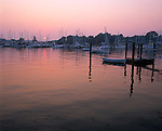 Mystic, CT<br /> Misty sunset over the harbor and boats at Noank