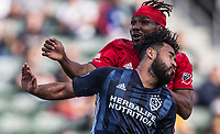CARSON, CA - FEBRUARY 15: Danilo Acosta #24 of the Los Angeles Galaxy battles with Ifunanyachi Achara #35 Toronto FC during a game between Toronto FC and Los Angeles Galaxy at Dignity Health Sports Park on February 15, 2020 in Carson, California.