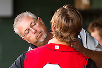 """Kannapolis Intimidators trainer Scott """"Fargo"""" Johnson works on Ross Wilson #2 during a game against the Hickory Crawdads at Fieldcrest Cannon Stadium on April 17, 2011 in Kannapolis, North Carolina.   Photo by Brian Westerholt / Four Seam Images"""