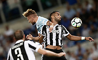 Calcio, Football - Juventus vs Lazio Italian Super Cup Final  <br /> Lazio's Ciro Immobile (l) in action with Juventu's Medhi Benatia (r) during the Italian Super Cup Final football match between Juventus and Lazio at Rome's Olympic stadium, on August 13, 2017.<br /> UPDATE IMAGES PRESS/Isabella Bonotto