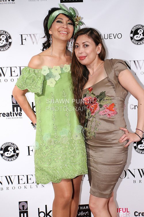 Fashion designer Joyce Penas Pilarsky (left) poses on red carpet with family, after her Joyce Penas Pilarsky Darling Collections Spring Summer 2015 fashion show, during Fashion Week Brooklyn Spring Summer 2015.