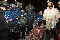 Televison crews swarm around Lance Mackey as he arrives in McGrath in first place Tuesday evening during Iditarod 2008