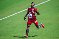 ORLANDO, FL - APRIL 24: Richie Laryea #22 of Toronto FC running towards the ball during a game between Vancouver Whitecaps and Toronto FC at Exploria Stadium on April 24, 2021 in Orlando, Florida.