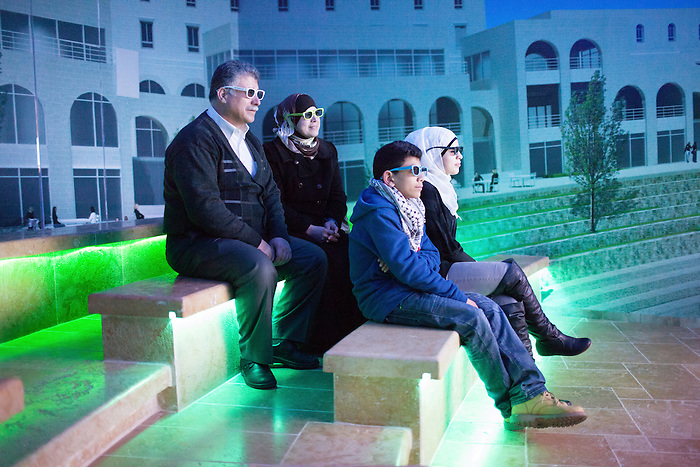 Jan 2013, A family is watching a promotional 3D video at the visitor center. The city is still in construction and houses are being sold off-plan.