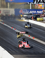 Feb 22, 2014; Chandler, AZ, USA; NHRA top fuel dragster driver Leah Pritchett during qualifying for the Carquest Auto Parts Nationals at Wild Horse Motorsports Park. Mandatory Credit: Mark J. Rebilas-USA TODAY Sports