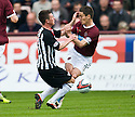 HEARTS' IAN BLACK IS INJURED IN THIS CHALLENGE WITH PARS JOE CARDLE WHICH RESULTED IN HIM GOING OFF MINUTES LATER