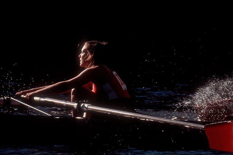 Rowing, Head of the Charles Regatta, Cambridge; Massachusetts; Charles River; Boston, New England, USA, collegiate woman athlete in the bow of an eight oared racing shell, .