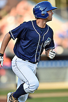 Asheville Tourists second baseman Michael Benjamin #18 runs to first during a game against the Lakewood BlueClaws at McCormick Field on May 3, 2014 in Asheville, North Carolina. The BlueClaws defeated the Tourists 7-4. (Tony Farlow/Four Seam Images)