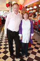 """NO REPRO FEE. 26/5/2011. NEW EDDIE ROCKET'S SHAKE SHOP. Greg and Julie Fortune are pictured in the new Eddie Rocket's Shake Shop. The design seeks to recall the vintage milkshake bars from 1950's America and re-imagine them for the 21st century. The new look aims to appeal to both young and old with a quirky and bold colour scheme and a concept of make-your-own milkshakes, based on the tag line """"You make it...We shake it!"""". Eddie Rocket's City Diner in the Stillorgan Shopping Centre in south Dublin has re-opened after an exciting re-vamp and the addition of a Shake Shop. Ten new jobs have been created with the Diner's re-launch bringing the total working in Eddie Rocket's Stillorgan to 30. Picture James Horan/Collins Photos"""