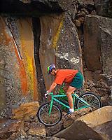 USA, Oregon, Extreme mountain biking through basalt boulders in Deschutes County. Credit as: Steve Terrill / Jaynes Gallery / DanitaDelimont.com