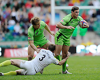Ed Jenkins of Australia is tackled by Rob Vickerman of England as Jesse Parahi of Australia looks on during the iRB Marriott London Sevens at Twickenham on Sunday 13th May 2012 (Photo by Rob Munro)