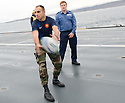 MEMBERS OF THE FRENCH MARINES AND THE ROYAL NAVY HAVE AN IMPROMPTU GAME OF RUGBY ON THE FLIGHT DECK OF HMS BULWARK AHEAD OF WATCHING THE RUGBY WORLD CUP QUARTER FINAL BETWEEN THEIR TWO COUNTRIES WHILST ON A BREAK FROM A JOINT EXERCISE IN LOCH EWE AND OFF THE SCOTTISH ATLANTIC COAST