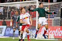 Harrison, NJ - Tuesday April 10, 2018: Tim Parker, Jesús Godinez during leg two of a  CONCACAF Champions League semi-final match between the New York Red Bulls and C. D. Guadalajara at Red Bull Arena. C. D. Guadalajara defeated the New York Red Bulls 0-0 (1-0 on aggregate).