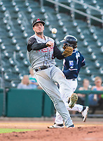 David Masters of the Travelers (8) throws runner out at first at Arvest Ballpark, Springdale, Arkansas, Wednesday, July 14, 2021 / Special to NWA Democrat-Gazette/ David Beach