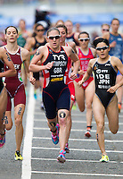 31 MAY 2014 - LONDON, GBR - Jodie Stimpson (GBR) (ENG) (centre, in dark blue with red and white) of Great Britain and England starts her first run lap during the 2014 ITU World Triathlon Series round in Hyde Park in London, Great Britain (PHOTO COPYRIGHT © 2014 NIGEL FARROW, ALL RIGHTS RESERVED)