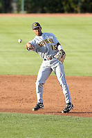 Marcus Semien #15 of the California Golden Bears warms up prior to a game against the Arizona State Sun Devils at Packard Stadium on March 27, 2010 in Tempe, Arizona..Photo By Bill Mitchell / Four Seam Images
