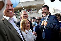 The leader of Lega right party Matteo Salvini (r) jokes with the leader of  Fratelli d Italia right party Giorgia Meloni and the candidate mayor of Rome for the right-center coalition Enrico Michetti (l) as they prepare to attend an electoral campaign press conference for the mayoral election in Spinaceto, a peripheral neighborhood in the west of Rome on October 1st 2021. Photo Andrea Staccioli Insidefoto